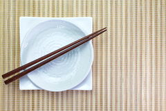 Chopsticks in asian set table Royalty Free Stock Photo