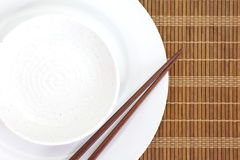 Chopsticks and Asian table setting Stock Photography