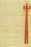 Chopsticks on bamboo background Royalty Free Stock Photo
