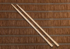 Chopsticks on bamboo background Stock Images