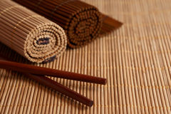 Chopsticks and Bamboo mat Stock Photo