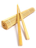 Chopsticks and bamboo mat Stock Photos