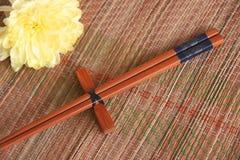 Chopsticks on bamboo mat Stock Photos