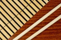 Chopsticks and bamboo mat Royalty Free Stock Photography