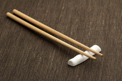 Chopsticks on a bamboo mat Stock Photo