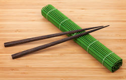 Chopsticks and bamboo mat Royalty Free Stock Photography
