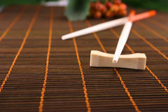 Chopsticks on a bamboo napkin Royalty Free Stock Images