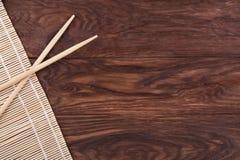 Chopsticks and bamboo napkin Royalty Free Stock Photos