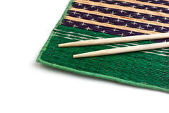 Chopsticks and bamboo plate Royalty Free Stock Image