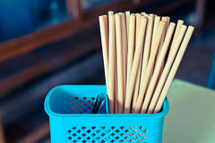 Chopsticks in blue plastic basket Royalty Free Stock Image