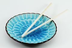 Chopsticks on Blue Plate Royalty Free Stock Photos