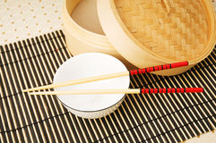 Chopsticks and bowl Royalty Free Stock Photos