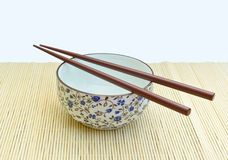Chopsticks on bowl Royalty Free Stock Photos