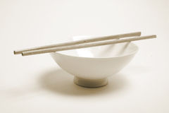 Chopsticks on Bowl Stock Photo