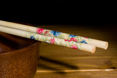 Chopsticks and bowl Royalty Free Stock Images
