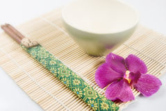 Chopsticks, Bowl, And Orchid Royalty Free Stock Photo