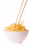 Chopsticks, bowl and noodles royalty free stock image