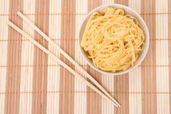 Chopsticks,bowl and noodles Stock Image