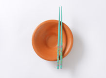 Chopsticks and bowl Stock Photography