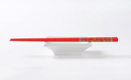 Chopsticks and bowl Stock Images