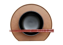 Chopsticks and bowl. On plate, white background royalty free stock image