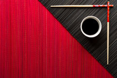 Chopsticks and bowl with soy sauce Royalty Free Stock Photography