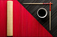 Chopsticks and bowl with soy sauce Royalty Free Stock Photo
