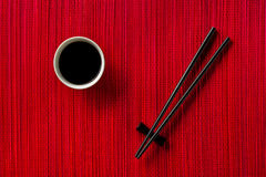 Chopsticks and bowl with soy sauce Royalty Free Stock Photos