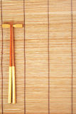 Chopsticks on brown bamboo matting background Royalty Free Stock Image