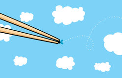 Chopsticks catching a fly on air Royalty Free Stock Image