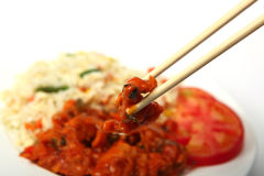 Chopsticks with chicken sweet and sour Stock Photography