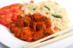 Chopsticks with chicken sweet and sour Royalty Free Stock Photography