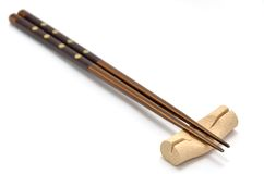 Chopsticks and chopstick rest. Stock Photo