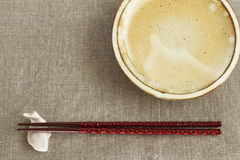 Chopsticks and chopstick rest and dishes Stock Image