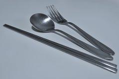 Chopsticks, colher e forquilha Fotografia de Stock Royalty Free