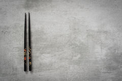 Chopsticks on concrete table stock photography
