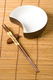 Chopsticks and dish Royalty Free Stock Images