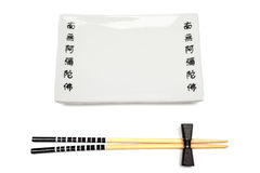 Chopsticks and dish isolated. Royalty Free Stock Images