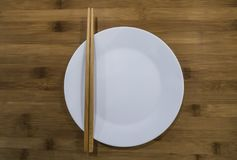 Chopsticks and dishes Stock Photography