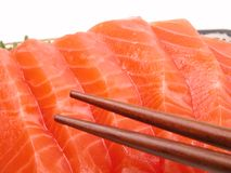 Chopsticks e carne salmon Fotos de Stock