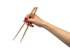 Chopsticks em uma mão Imagens de Stock