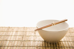 Chopsticks on an Empty Bowl. Isolated Stock Photos