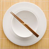 Chopsticks With Empty Bowl and Plate Stock Images