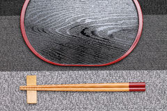 Chopsticks and empty tray. On table background Stock Photography