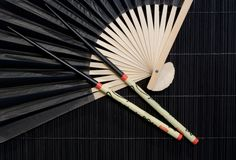 Chopsticks and fan Stock Photography