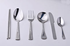 Chopsticks fork, knife and spoon isolated Stock Images