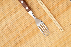 Chopsticks and a fork Royalty Free Stock Image