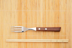 Chopsticks and a fork Stock Photo