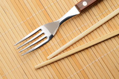 Chopsticks and a fork Stock Images