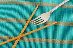 Chopsticks or fork Stock Photo